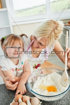 Cute woman baking cookies with her daughter