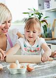 Lucky woman baking cookies with her daughter