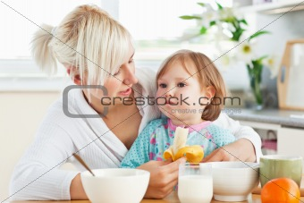 Attractive mother having breakfast with her daughter