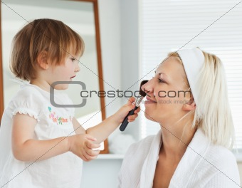 Beaming mother taking care of her child