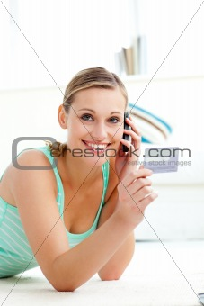 Attractive caucasian woman talking on phone holding a card