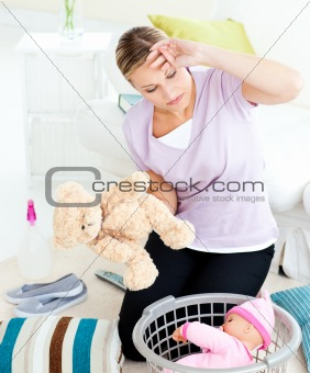 Tired woman doing housework at home