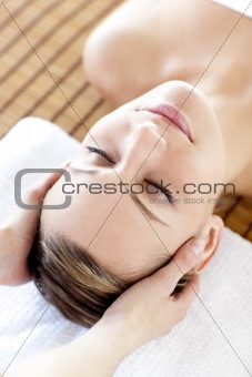 Caucasian relaxed woman having a head massage