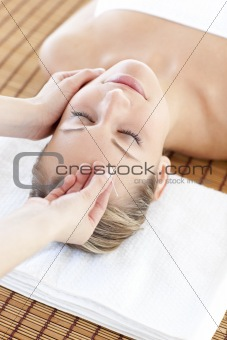 Bright woman having a head massage
