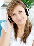 Attractive woman listening music with headphones at home