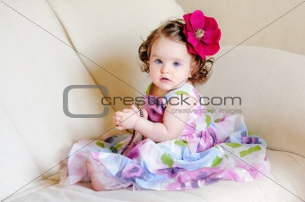 adorable baby-girl with flower and necklace