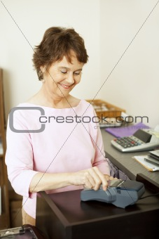 Clerk at Credit Card Terminal