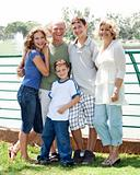 Family posing infront of lake
