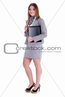 Charming business woman standing and holding her office file