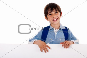 Boy standing behind the blank board