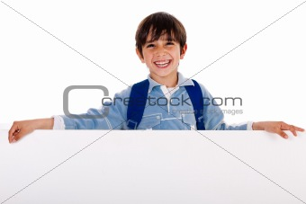 Charming kid holding blank board