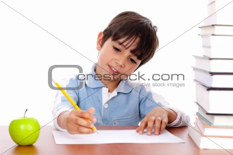 Cute young boy busy in drawing