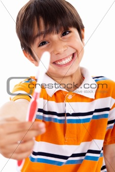 Boy showing the toothbrush