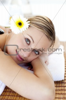 Portrait of an attractive young woman smiling at the camera in a