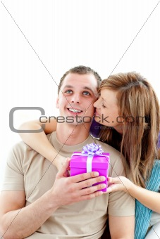 Attractive boyfriend giving a present to his cute girlfriend