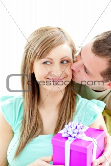 Attractive boyfriend giving a present to his smiling girlfriend