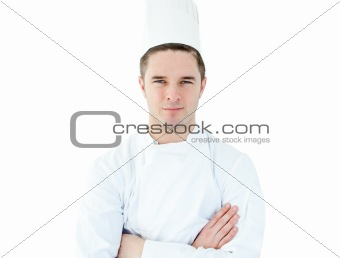 Attractive young chef  with folded arms