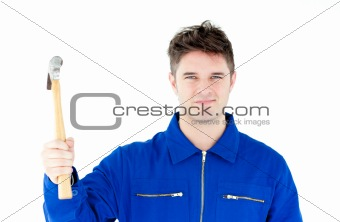 Smiling mechanic holding a hammer looking at the camera