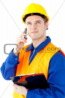 Charismatic worker talking on phone holding a clipboard