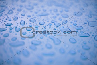 Abstract background - water drops on blue plastic