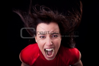 beautiful young woman with her hair in the wind, screaming in fury