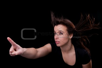 beautiful young woman with her hair in the wind, finger in the air, looking up