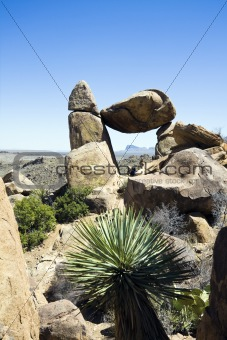 Tourist sitting under Balanced Rock