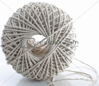 a ball of string on white background