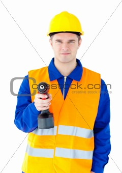Young male worker wearing helmet and holding boring machine