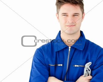 Charismatic caucasian worker holding tool