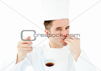 Caucasian young cook tasting a delicious soup