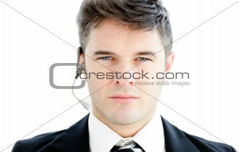 Assertive young businessman with headphones looking at the camer