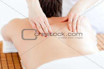 Caucasian young man having a back massage