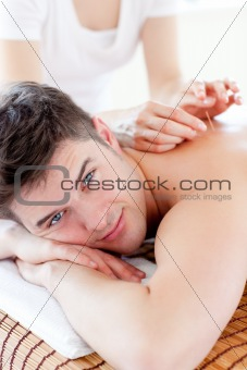 Portrait of a cute man relaxing in a Spa center