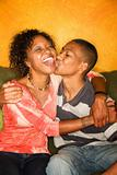 Happy African-American woman and teen boy