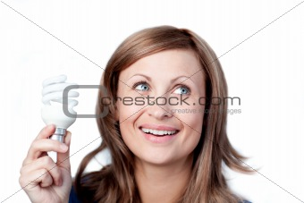 Bright woman holding a light bulb