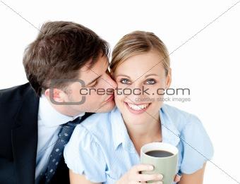 Attentive businessman kissing his girlfriend at her cheek