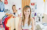 Delighted young woman smiling at the camera doing shopping with