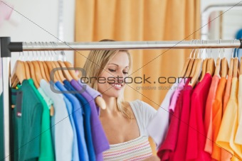 Cute young woman holding a colorful shirt