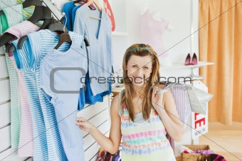 Charming caucasian woman doing shopping smiling at the camera