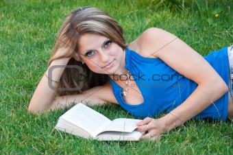 Beautiful girl reads the book