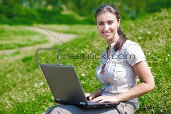 Beautiful woman with notebook on hill