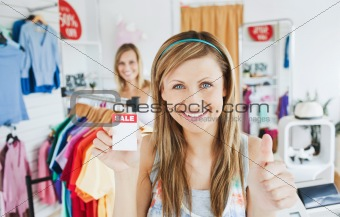 Animated young woman holding a sales paper into the camera with