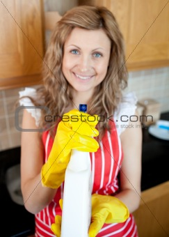 Cheerful blond woman holding cleansing agent into the camera