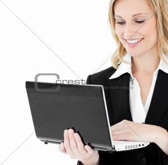Ambitious businesswoman using her laptop