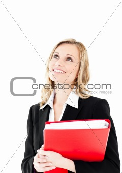 Thoughtful businesswoman with a red folder