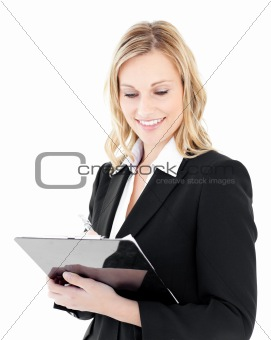 Ambitious young businesswoman taking notes on her clipboars