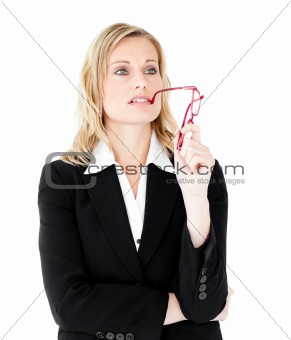 Thoughtful young businesswoman  holding glasses