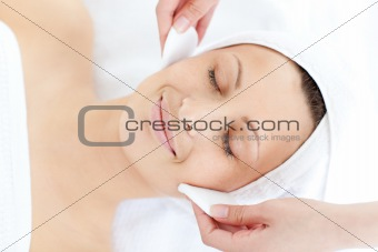 Sleeping woman having a massage