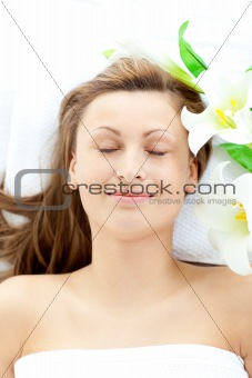 Positive young woman lying on a massage table